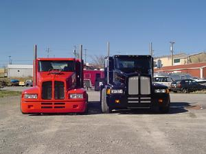Click image for larger version  Name:red_and_black_trucks_front_on.jpg Views:112 Size:102.9 KB ID:15686